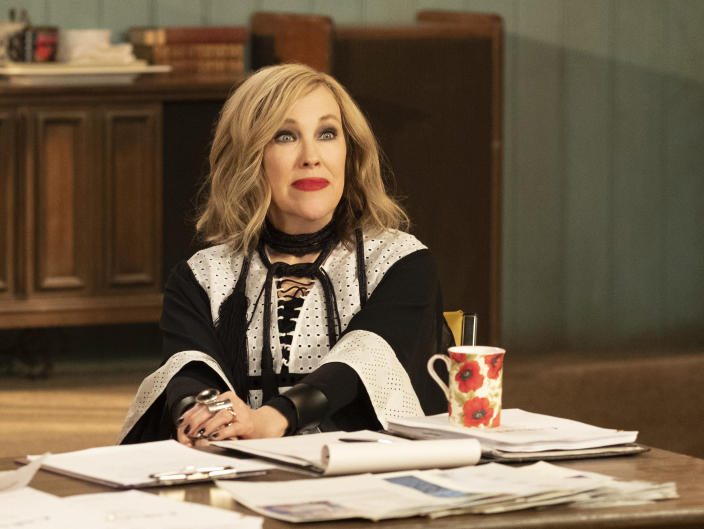 """This image released by Pop Tv shows Catherine O'Hara in a scene from """"Schitt's Creek."""" O'Hara won the award for best actress in a television series, musical or comedy, for """"Schitt's Creek"""" at the Golden Globe awards on Sunday, Feb. 28, 2021. (Pop TV via AP)"""