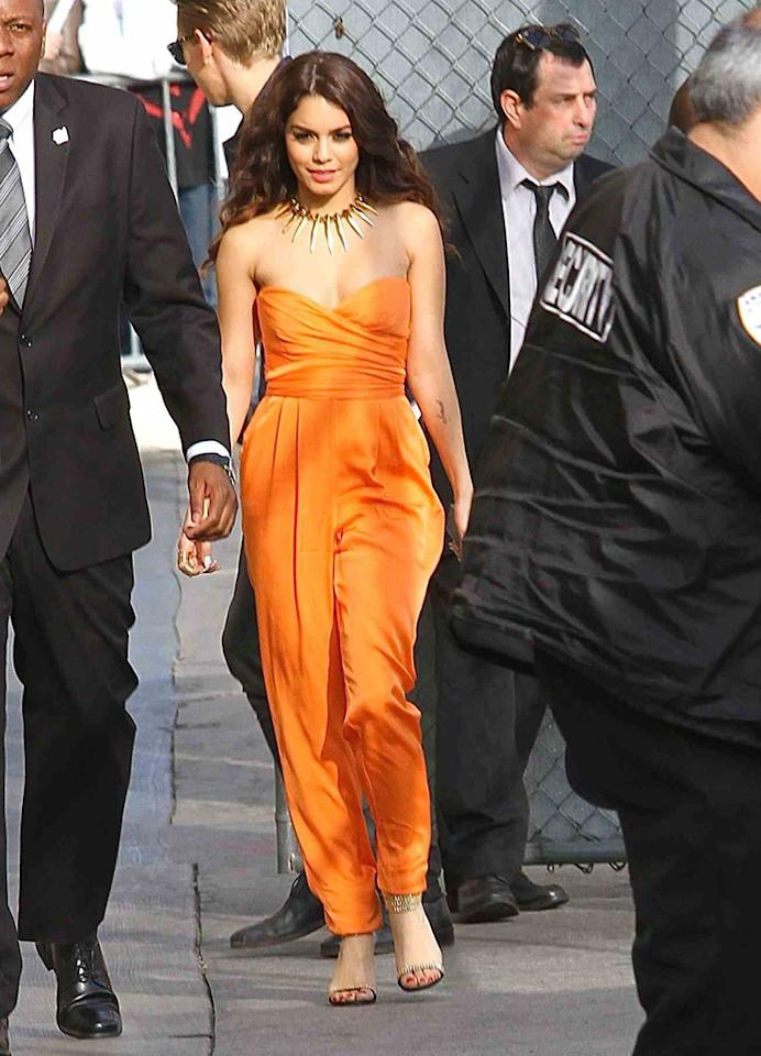 "Very few women can pull off the polarizing jumpsuit, and, unfortunately, Vanessa Hudgens isn't one of them. On Tuesday, the former ""High School Musical"" hottie sauntered into a taping of ""Jimmy Kimmel Live!"" in this orange atrocity, which featured a daringly low-cut bodice. Van may show off quite a bit of flesh in her new flick, ""Spring Breakers,"" but that doesn't mean she should risk a nip-slip in her day-to-day life. (3/19/2013)"