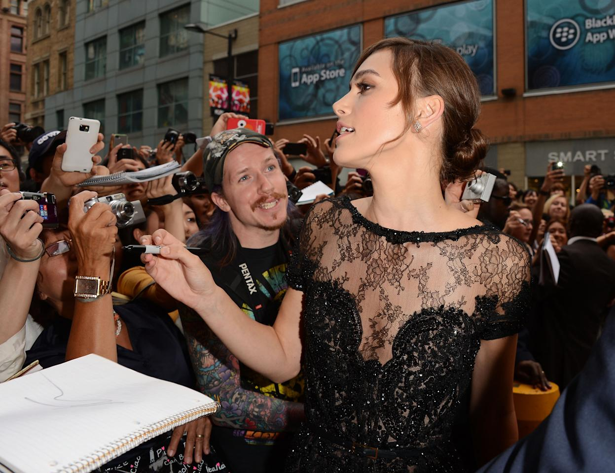 Only Kiera Knightley can look this glamorous in a candid shot - but rather than her gorgeous profile, we like this photo mostly for the guy who's completely enamoured with her. Well, rightfully so.