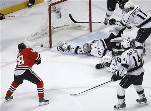 Chicago Blackhawks right wing Patrick Kane (88) scores a goal during the first period in Game 5 of the NHL hockey Stanley Cup playoffs Western Conference finals against the Los Angeles Kings, Saturday, June 8, 2013, in Chicago. (AP Photo/Charles Rex Arbogast)