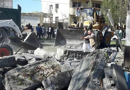 General view of damages after a bomb inside a car exploded outside a police station in Chabahar