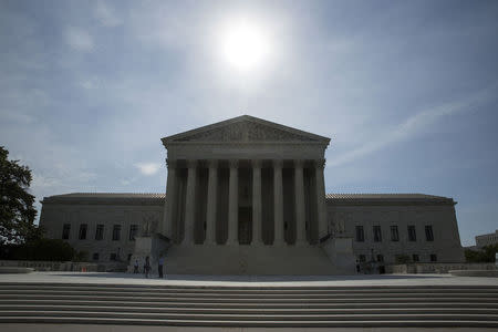 The sun rises over the Supreme Court in Washington
