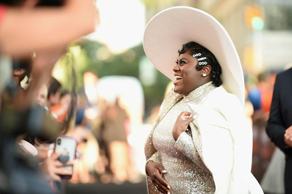 """<p>Actress <strong>Danielle Brooks</strong> adds <a href=""""https://www.goodhousekeeping.com/beauty/hair/g30681266/cute-hair-clips-barrettes/"""" rel=""""nofollow noopener"""" target=""""_blank"""" data-ylk=""""slk:sparkly barrettes"""" class=""""link rapid-noclick-resp"""">sparkly barrettes</a> to her finger waves for a red carpet-worthy natural hairstyle. </p>"""