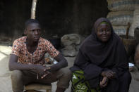 """Murjanatu Rabiu, mother of freed schoolboy, Habubakar Liti, speaks with Associated Press at their family in Ketare, Nigeria, Saturday Dec. 19, 2020. """"By the time I saw my son, I didn't know when I started crying because of the condition I saw the children, that's why I started crying."""" Nigeria's freed schoolboys have reunited with their joyful parents after being held captive for nearly a week by gunmen allied with jihadist rebels in the country's northwest. Relieved parents hugged their sons tightly on Saturday in Kankara, where more than 340 boys were abducted from the Government Science Secondary school on the night of Dec. 11. (AP Photo/Sunday Alamba)"""