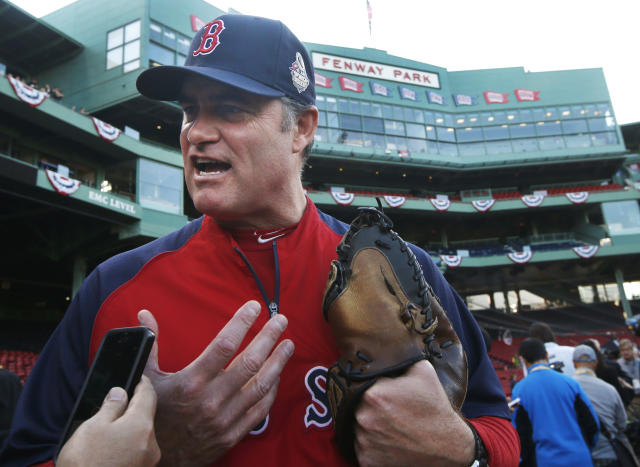 Boston Red Sox manager John Farrell speaks to a reporter during team baseball practice in at Fenway Park in Boston, Monday, Oct. 21, 2013. the Red Sox are preparing for Game 1 of the World Series against the St. Louis Cardinals on Wednesday. (AP Photo/Elise Amendola)