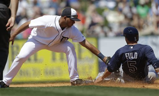 Tampa Bay Rays' Sam Fuld is tagged out at second by Detroit Tigers shortstop Jhonny Peralta on a steal attempt during the fourth inning of a spring training baseball game, Friday, March 29, 2013 in Lakeland, Fla. (AP Photo/Carlos Osorio)