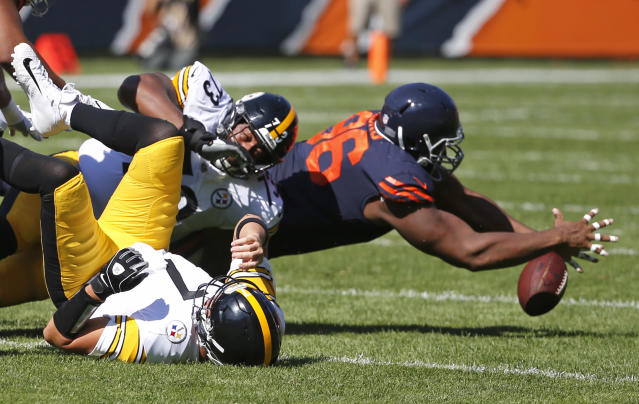 <p>Chicago Bears defensive end Akiem Hicks (96) recovers the loose ball after Pittsburgh Steelers quarterback Ben Roethlisberger (7) was sacked during the first half of an NFL football game, Sunday, Sept. 24, 2017, in Chicago. (AP Photo/Charles Rex Arbogast) </p>