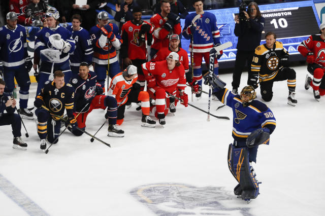 St. Louis Blues goalie Jordan Binnington (50) celebrates after winning the Skills Competition save streak competition, part of the NHL hockey All-Star weekend, Friday, Jan. 24, 2020, in St. Louis. (AP Photo/Jeff Roberson)