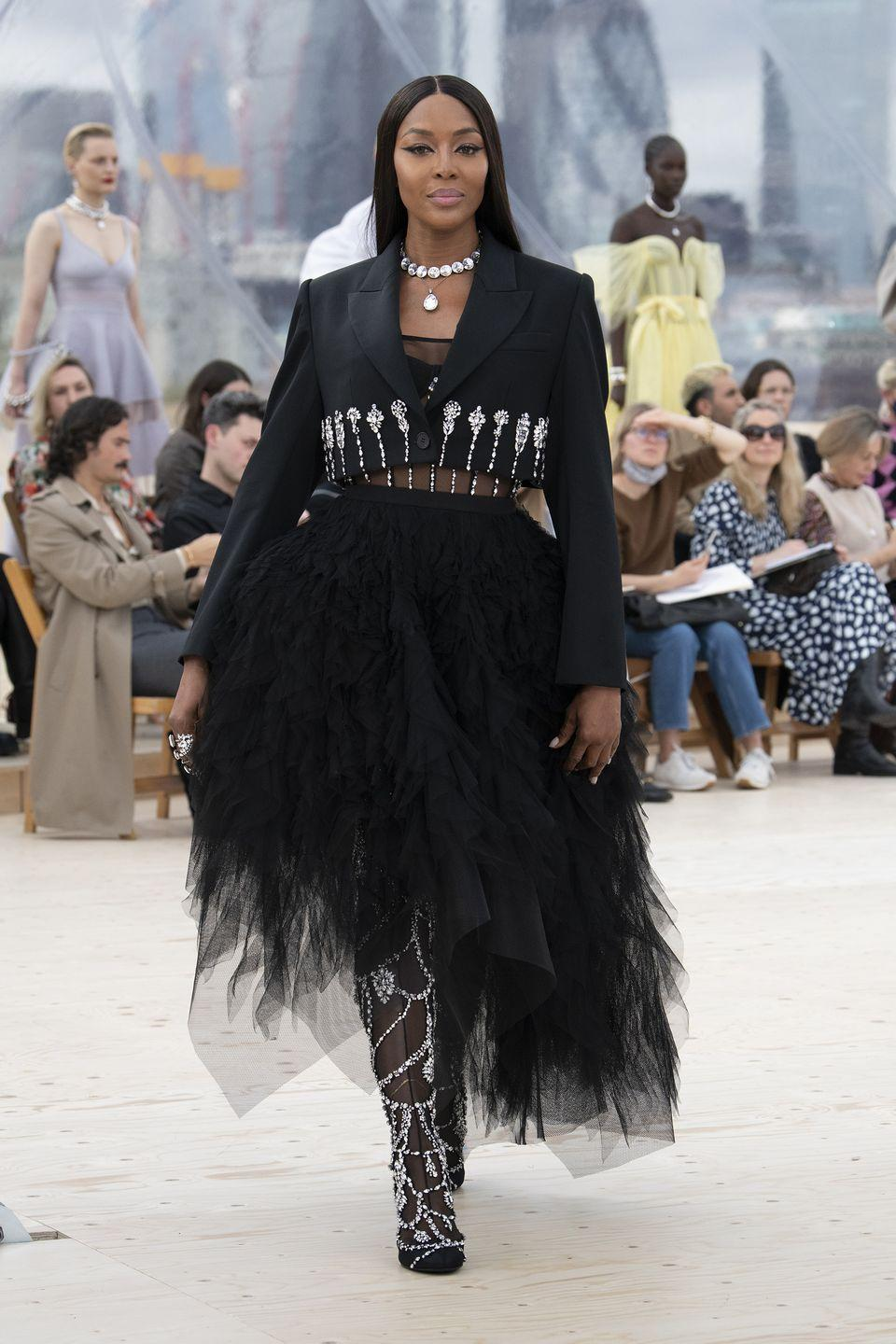 """<p>Naomi Campbell closed the spring/summer 2022 Alexander McQueen show, marking the first time the British brand has shown in London for five years. Titled 'London Skies', the catwalk event was held in a specially constructed dome overlooking the city skyline.</p><p>""""I'm interested in immersing myself in the environment in which we live and work in London, and in the elements as we experience them each day,"""" said creative director Sarah Burton.</p><p>The elements were depicted throughout the collection, from dreamlike cloud prints, to clothes inspired by the unpredictability of storm chasing, and variations on the glittering night sky. </p>"""