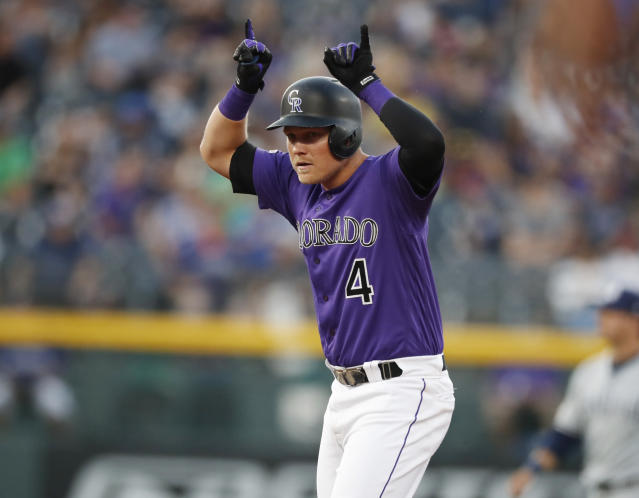 Colorado Rockies' Pat Valaika gestures to the dugout after hitting a double off San Diego Padres starting pitcher Eric Lauer during the second inning of a baseball game Saturday, Sept. 14, 2019, in Denver. (AP Photo/David Zalubowski)