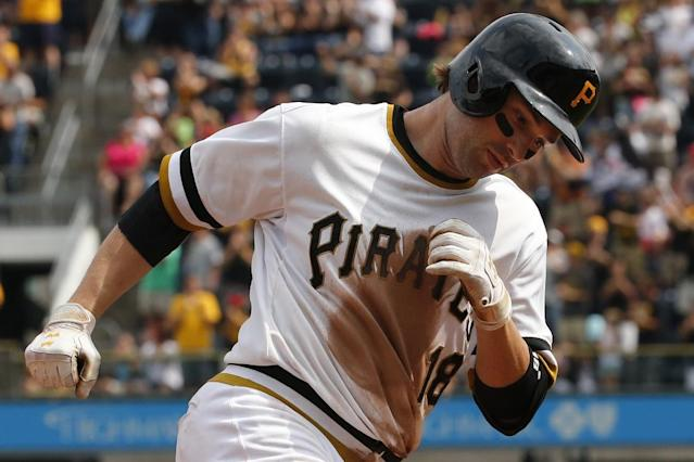 Pittsburgh Pirates' Neil Walker rounds third after hitting a solo home run off Colorado Rockies relief pitcher Matt Belisle during the seventh inning of a baseball game in Pittsburgh, Sunday, July 20, 2014. The Pirates won 5-3. (AP Photo/Gene J. Puskar)