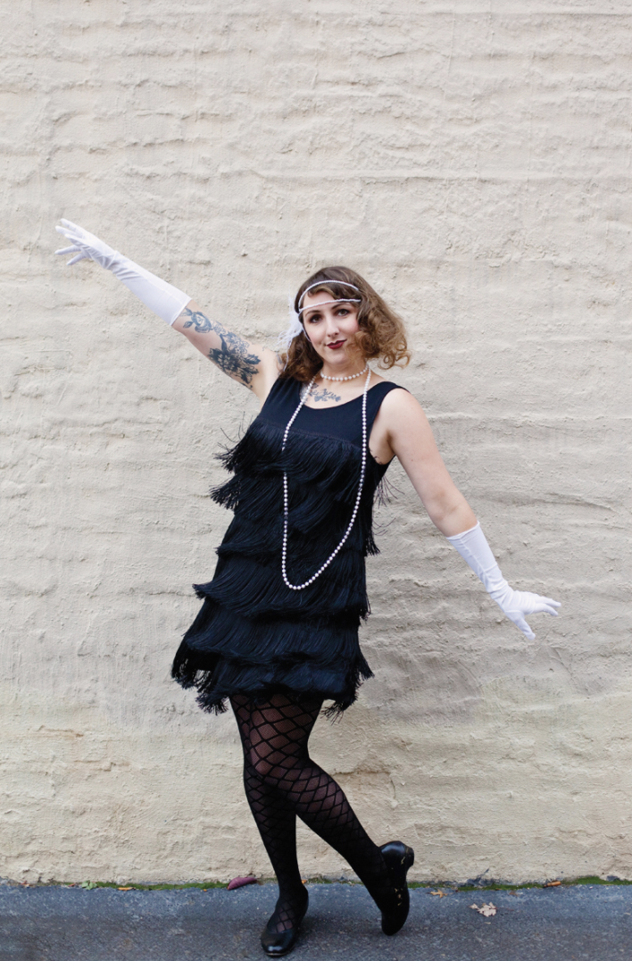 """<p>Sew fringe onto a basic jersey dress for instant 1920s glam. Don't know how to stitch? Hot glue the material on instead. </p><p><a class=""""link rapid-noclick-resp"""" href=""""https://abeautifulmess.com/diy-flapper-costume/"""" rel=""""nofollow noopener"""" target=""""_blank"""" data-ylk=""""slk:GET THE TUTORIAL"""">GET THE TUTORIAL</a></p><p><a class=""""link rapid-noclick-resp"""" href=""""https://www.amazon.com/dp/B00SNT32PU?tag=syn-yahoo-20&ascsubtag=%5Bartid%7C10072.g.33547559%5Bsrc%7Cyahoo-us"""" rel=""""nofollow noopener"""" target=""""_blank"""" data-ylk=""""slk:SHOP FRINGE TRIM"""">SHOP FRINGE TRIM</a></p>"""