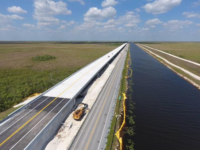 A 2.6-mile bridge along the Tamiami Trail is expected to be finished next year, adding to a one-mile bridge completed in 2013. The two bridges will allow water managers to raise water next to the aging road to 8.5 feet and increase the amount of water moved into Shark River Slough and Taylor Slough to revive ailing marshes. Everglades National Park