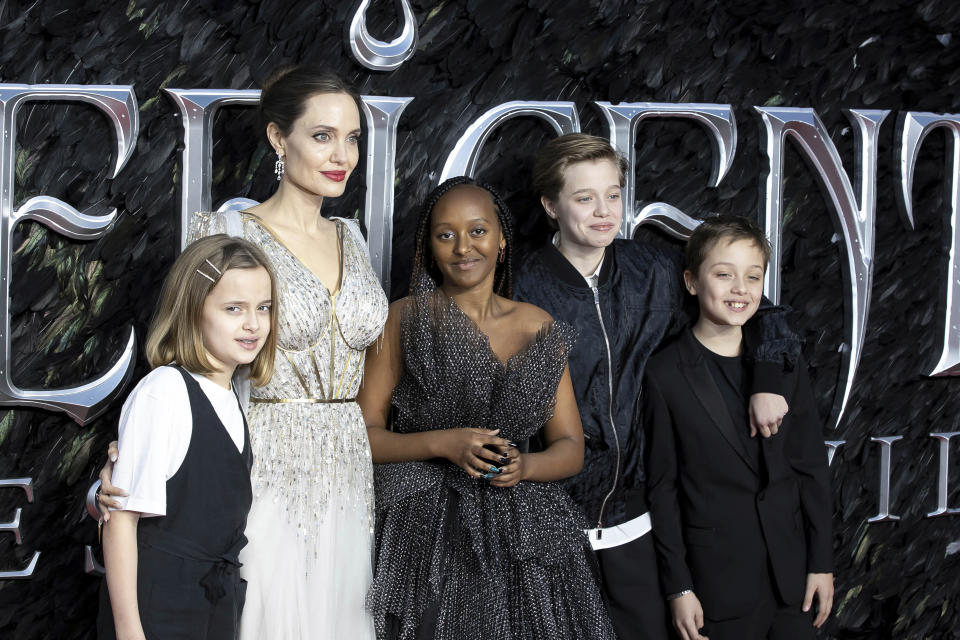 Actress Angelina Jolie, 2nd Left, and her children Vivienne Jolie-Pitt, Zahara Jolie-Pitt, Shiloh Jolie-Pitt and Knox Leon Jolie-Pitt, pose for photographers on arrival at the Premiere of the film 'Maleficent Mistress of Evil' in central London on Wednesday, Oct. 9, 2019. (Photo by Grant Pollard/Invision/AP)