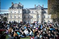 People enjoyed the sunshine in central Paris over the weekend despite rising case numbers in the region
