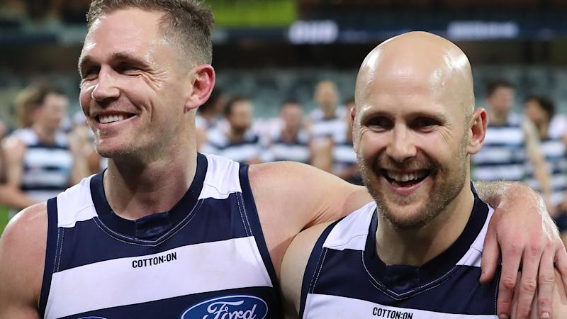 Gary Ablett and Joel Selwood of the Cats leave the field following victory in the round 5 match against the Gold Coast Suns. (Photo by Graham Denholm/AFL Photos via Getty Images )