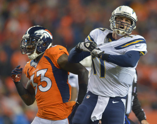 San Diego Chargers quarterback Philip Rivers (17) reacts after a play against the Denver Broncos in the first quarter of an NFL football game, Thursday, Dec. 12, 2013, in Denver. (AP Photo/Jack Dempsey)
