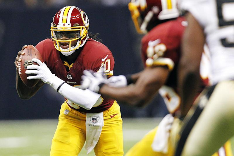 Washington Redskins quarterback Robert Griffin III (10) scrambles in the first half of an NFL football game against the New Orleans Saints in New Orleans, Sunday, Sept. 9, 2012. (AP Photo/Gerald Herbert)