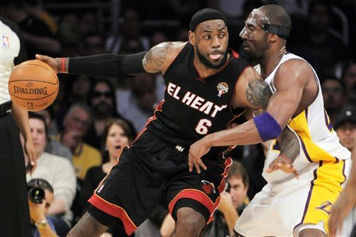 Miami Heat forward LeBron James (6) backs down on Los Angeles Lakers guard Kobe Bryant during the first half of their NBA basketball game, Sunday, March 4, 2012, in Los Angeles. (AP Photo/Mark J. Terrill)