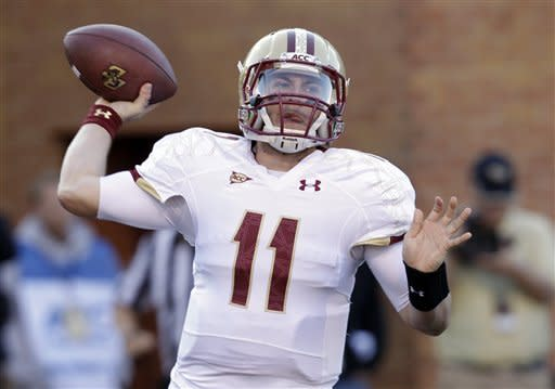 Boston College's Chase Rettig (11) looks to pass against Wake Forest during the first half of an NCAA college football game in Winston-Salem, N.C., Saturday, Nov. 3, 2012. (AP Photo/Chuck Burton)
