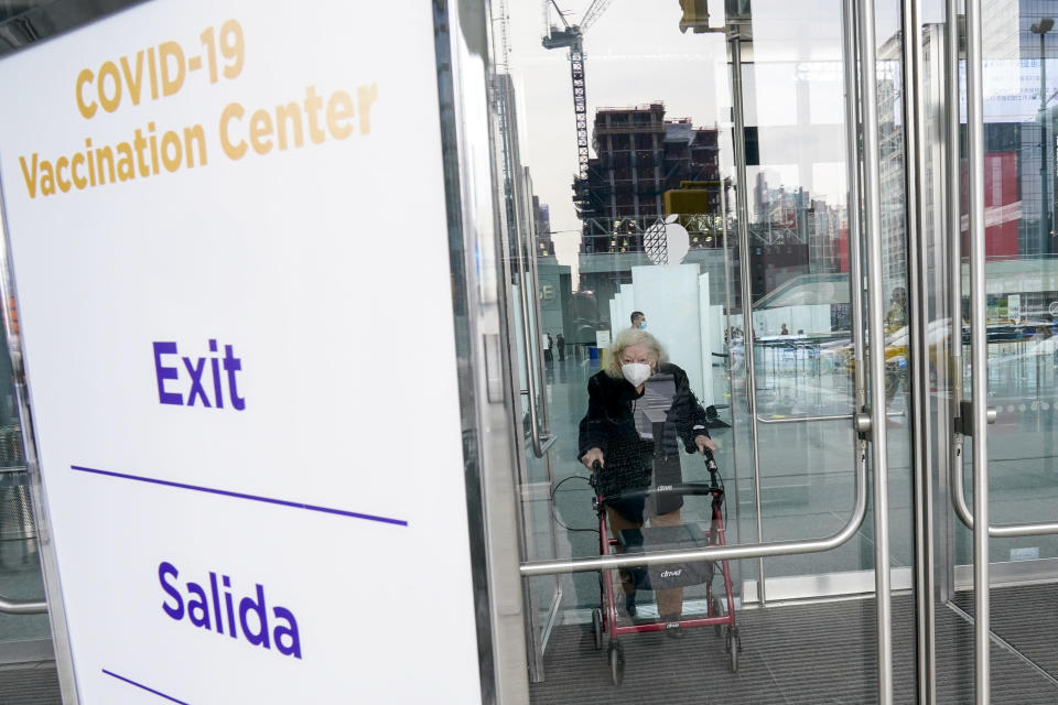 FILE - In this Jan. 13, 2021, file photo, Muriel Mandell, 99, leaves a New York State COVID-19 vaccination site at the Jacob K. Javits Convention Center after receiving her first dose in New York. An increasing number of COVID-19 vaccination sites around the U.S. are canceling appointments because of vaccine shortages in a rollout so rife with confusion and unexplained bottlenecks. (AP Photo/Mary Altaffer, File)