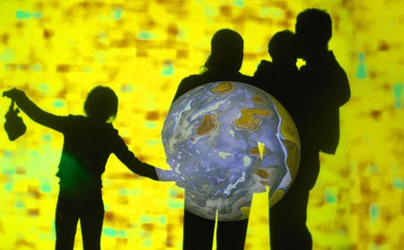 """For the installation """"The Hidden Light,"""" Dan Goods used a projector and a spotlight to illustrate the difficulty of locating other planets."""
