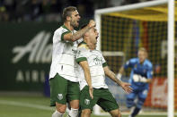 Portland Timbers forward Felipe Mora, front right, celebrates his second-half goal against the Colorado Rapids during an MLS soccer match Wednesday, Sept. 15, 2021, in Portland, Ore. (Sean Meagher/The Oregonian via AP)
