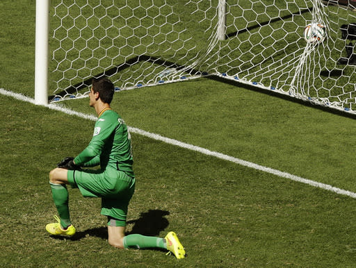 Belgium's goalkeeper Thibaut Courtois is on his knee as Argentina's Gonzalo Higuain kick goes in for a goal during the World Cup quarterfinal soccer match between Argentina and Belgium at the Estadio Nacional in Brasilia, Brazil, Saturday, July 5, 2014. (AP Photo/Thanassis Stavrakis)