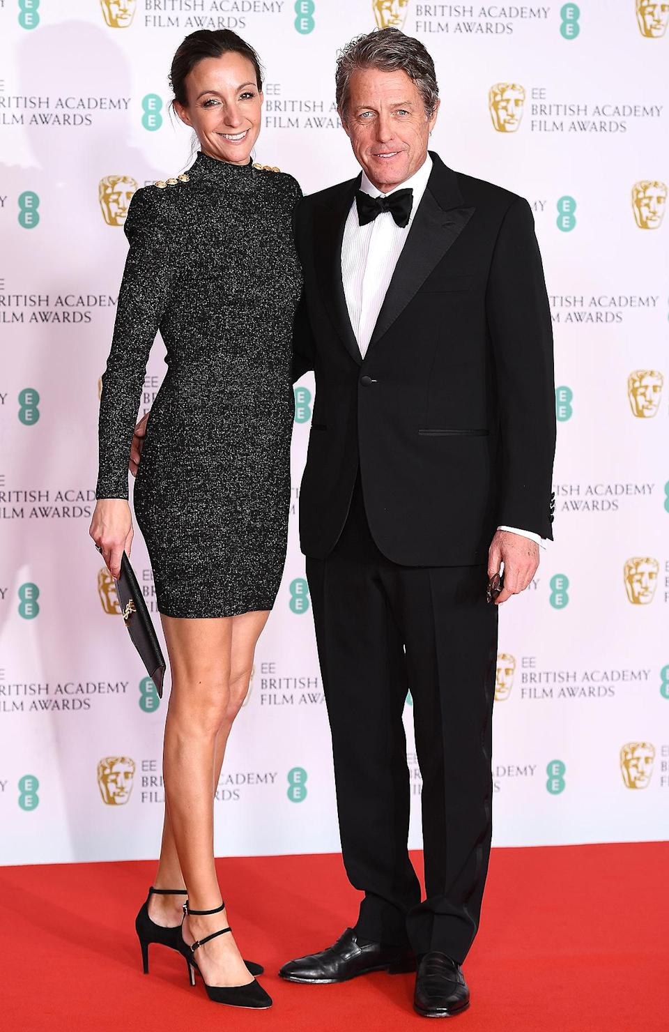 <p>The actor wears a black tuxedo and bow tie, while wife Anna Eberstein wears a shimmery long-sleeve mini dress.</p>