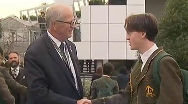 Trinity Grammar's Rohan Brown returned to work on Tuesday after being sacked for cutting a student's hair. Source: 7 News