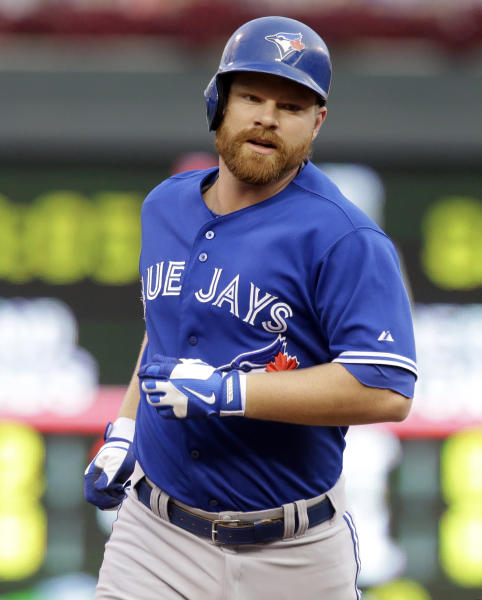 Toronto Blue Jays' Adam Lind rounds second base on his three-run home run off Minnesota Twins pitcher Kevin Correia in the first inning of a baseball game, Saturday, Sept. 7, 2013 in Minneapolis. (AP Photo/Jim Mone)