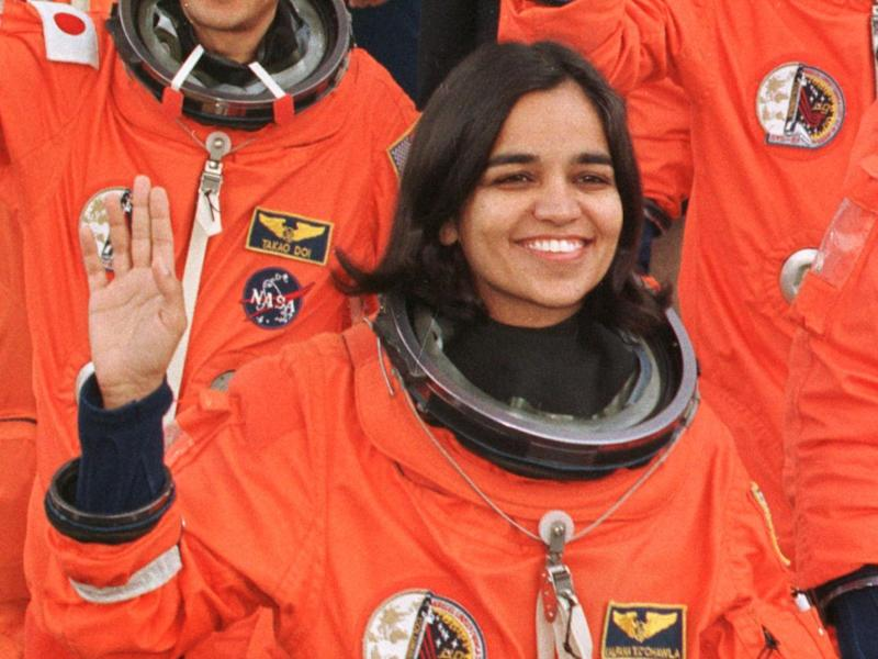 Kalpana Chawla waves as she walks out of the Operations and Checkout Building at the Kennedy Space Center: TONY RANZE/AFP/Getty Images