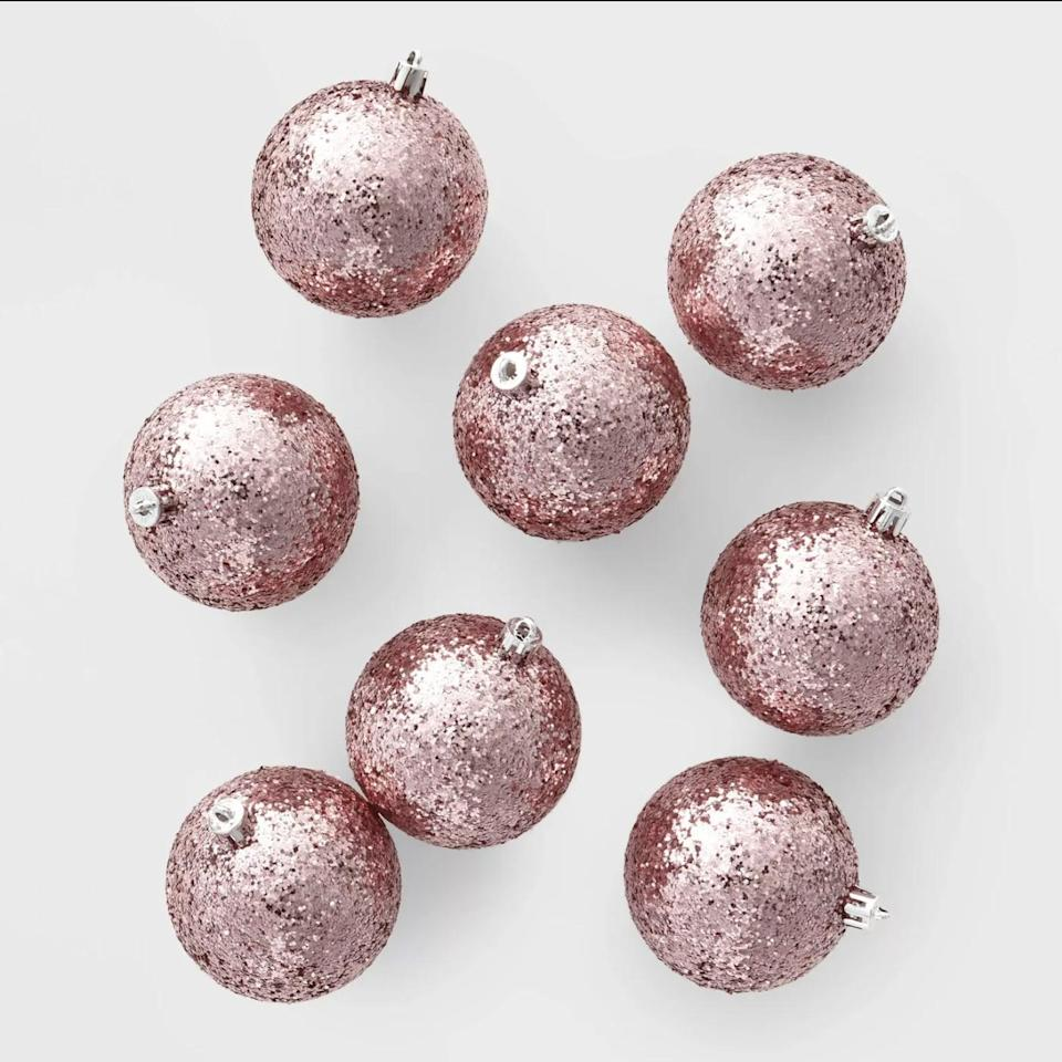<p>This <span>8ct 70mm Chunky Glitter Christmas Ornament Set</span> ($5) is a budget-friendly way to introduce some rose gold into your tree this year. </p>