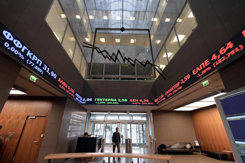 The Athens stock market plunged more than six percent before recovering slightly at the close as investors fretted over whether the new radical left government will renege on Greece's international bailout (AFP Photo/Louisa Gouliamaki)