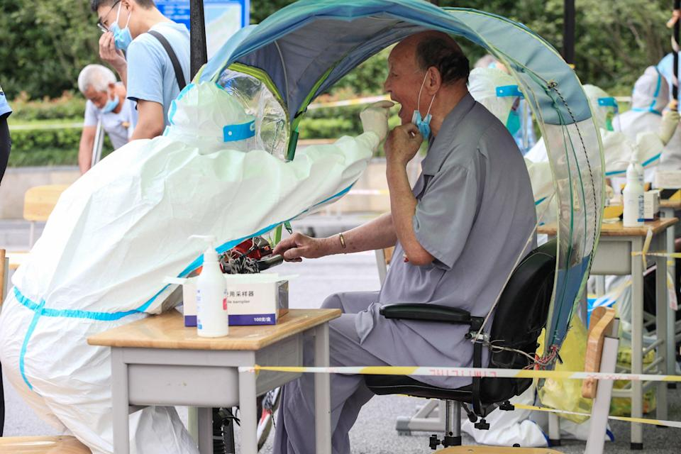 File: An elderly man receives a nucleic acid test for the Covid-19 coronavirus in Nanjing in eastern Jiangsu province ( Getty Images)