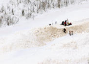 FILE - Mountain Rescue personnel work to free the body of an avalanche victim at the base of the Five Fingers Bowl near Aspen, Colo., in this March 6, 2005, file photo. This has been an highly dangerous avalanche season, with 30 confirmed fatalities. It's involved different recreational activities — snowboarding, skiing, snowmobiling, hiking — and includes various ages and experience levels. (AP Photo/The Aspen Times, Paul Conrad, File)