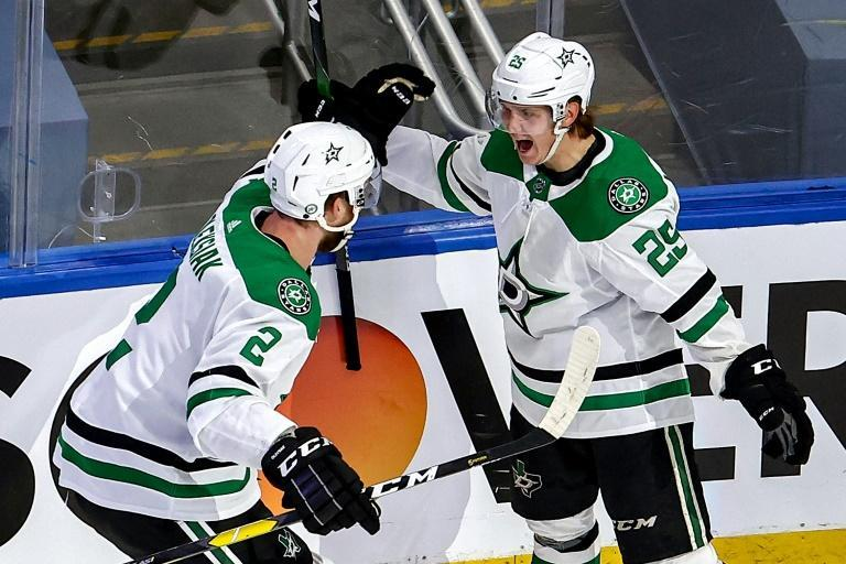Dallas Stars Joel Kiviranta, 25, is congratulated by teammate Jamie Oleksiak after scoring the overtime winner against the Colorado Avalanche in game seven of the Western Conference second round playoff series