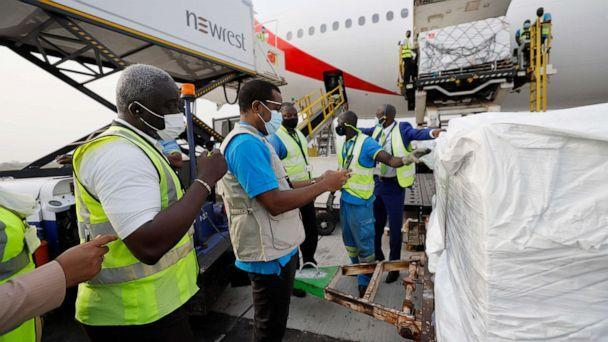 PHOTO: Staffers unload the first shipment of COVID-19 vaccines distributed by the COVAX facility at the Kotoka International Airport in Accra, the capital of Ghana, Feb. 24, 2021. (Francis Kokoroko/COVAX via UNICEF)