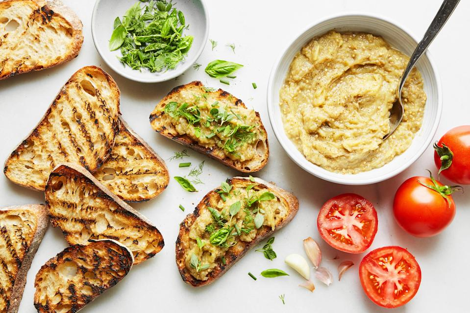 """Summer appetizers that start with charred eggplant and grilled bread are always delicious, but cookbook author Olia Hercules ups the ante, mixing the luscious eggplant with salt, pepper, and butter. Slather it onto toast that's rubbed with garlic and tomato and you've got the ideal appetizer for a bbq. <a href=""""https://www.epicurious.com/recipes/food/views/burnt-eggplant-butter-on-tomato-toasts?mbid=synd_yahoo_rss"""" rel=""""nofollow noopener"""" target=""""_blank"""" data-ylk=""""slk:See recipe."""" class=""""link rapid-noclick-resp"""">See recipe.</a>"""