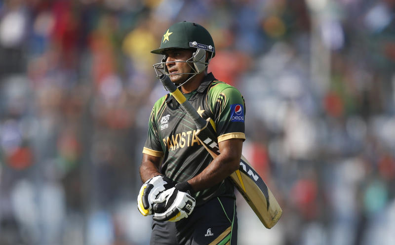 Pakistan captain Mohammad Hafeez leaves the ground after losing his wicket during their ICC Twenty20 Cricket World Cup match against Bangladesh in Dhaka, Bangladesh, Sunday, March 30, 2014. (AP Photo/Aijaz Rahi)