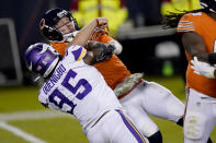 Chicago Bears quarterback Nick Foles tries to throw under pressure from Minnesota Vikings defensive end Ifeadi Odenigbo (95) during the second half of an NFL football game Monday, Nov. 16, 2020, in Chicago. Foles was injured on the play and left the game. (AP Photo/Charles Rex Arbogast)