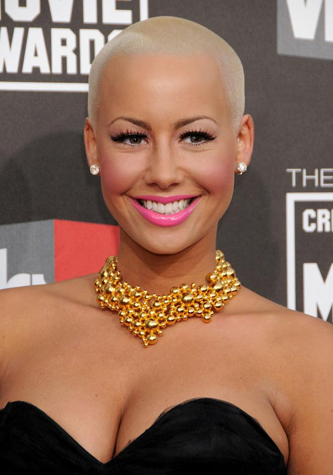 <p>Socialite and host Amber Rose always looks chic and sexy with her signature platinum buzz cut. (Photo: FilmMagic) </p>