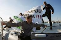 Fishermen hold a banner during a protest against undersea oil exploration in the Adriatic Sea in Bar, Montenegro, November 14, 2018. REUTERS/Stevo Vasiljevic