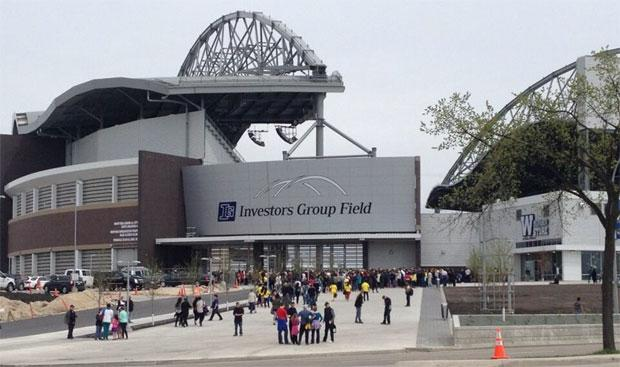 People ariving for the firt ever event at Winnipeg's new Investors Group Field.