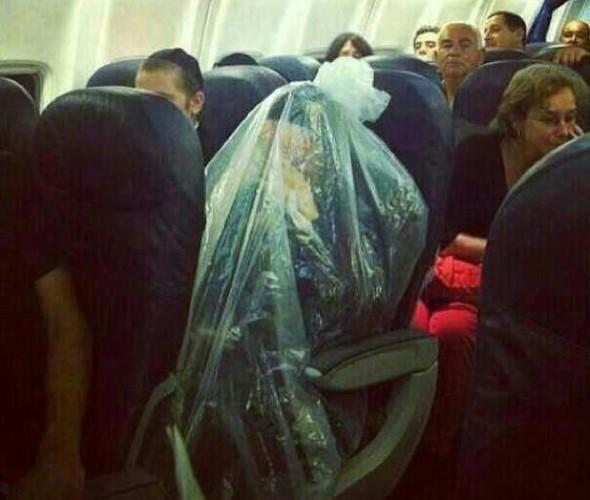 Orthodox Jew wraps himself in plastic bag on plane flying over cemetery