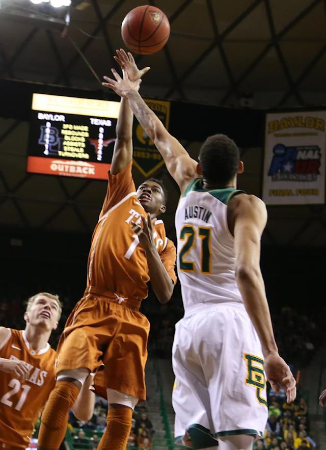 Texas guard Isaiah Taylor, left, is pressured by Baylor center Isaiah Austin (21) in the first half of a NCAA college basketball game, Saturday, Jan. 25, 2014, in Waco, Texas. (AP Photo/Waco Tribune Herald, Rod Aydelotte)