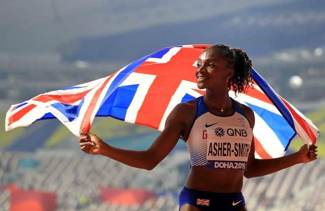 Dina Asher-Smith celebrates the silver medal (Mike Egerton/PA)