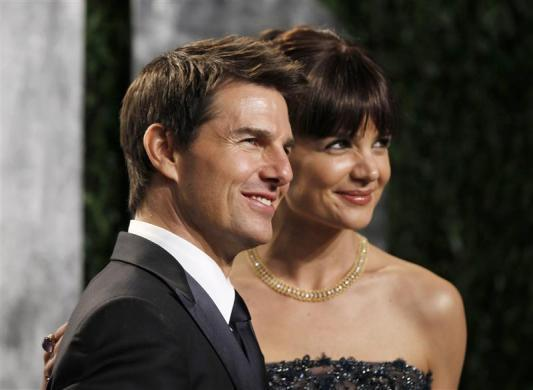 Actor Tom Cruise and his wife, actress Katie Holmes, arrive at the 2012 Vanity Fair Oscar party in West Hollywood, California February 26, 2012.