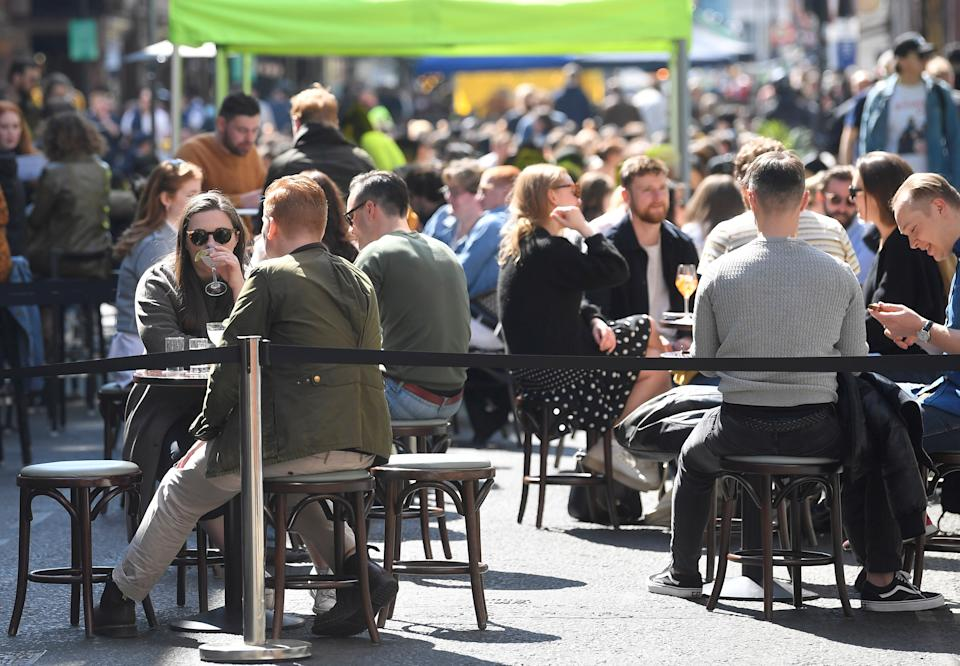 People drink and eat in outdoor street dining areas, as lockdown restrictions are eased amidst the spread of the coronavirus disease (COVID-19) pandemic in Soho, London, Britain, April 24, 2021. REUTERS/Toby Melville