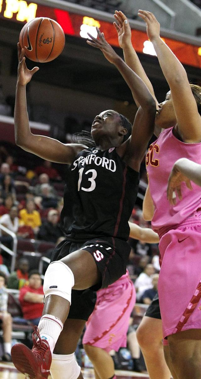 Stanford forward Chiney Ogwumike (13) pulls down a rebound against Southern California forward Deanna Calhoun, right, during the first half of an NCAA college basketball game Friday, Feb. 21, 2014, in Los Angeles. (AP Photo/Alex Gallardo)